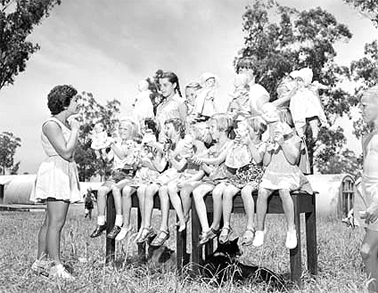 Outdoor children's activities at the Villawood Migrant Centre, 1956. Courtesy National Archives of Australia