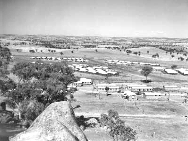 Looking west showing compounds of the Cowra prisoner of war camp with the group headquarters buildings in the foreground. AWM