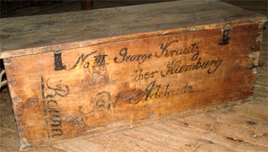 Timber cabin chest from collection with the inscription clearly visible on the side. Image courtesy of the Jindera Museum