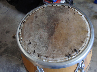 Cowhide stretched on a Uruguayan drum with new tension fittings.