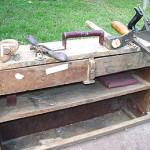 """I hand-made the toolbox and various work tools of mine including a chisel used to chip and fashion wood and a lathe to smooth and shave wood surfaces. I brought it over from Greece to help me find work."""