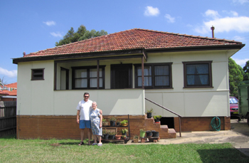 Maria Cebulski and her son Richard outside the house her husband started building in 1956.