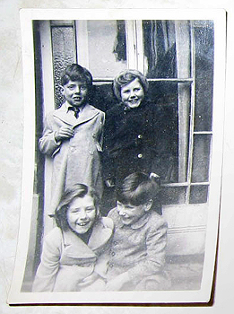 [Clockwise from top left:] Siblings Reggie, Katherine, Douglas and Gwen in their courtyard at home, Grimsby, England, 1952