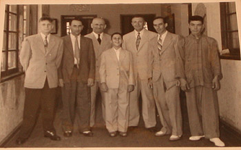 """My father and some of his employees at my Barmitzvah. This was one of the last events before we left Shanghai for Sydney in 1949."""