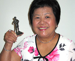Helen Sham-Ho with her scout statue