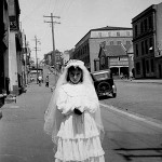 Gina Mascaro nee Marasco dressed for her first 'Holy Communion' outside her house at 106 Forbes Street, East Sydney, NSW 15 August 1954. Courtesy of the Mascaro family