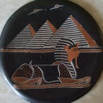 """The plate is about 12cm in diameter with embossed image of pyramids and sphinx. I brought it over from Egypt to remind me of my life there."""