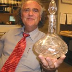 """This crystal decanter has always been used in our family for the Kiddush wine. It was bought the same time as the matzah cover."""