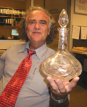 """This crystal decanter has always been used in our family for the <em>Kiddush</em> wine. It was bought the same time as the <em>matzah</em> cover."""