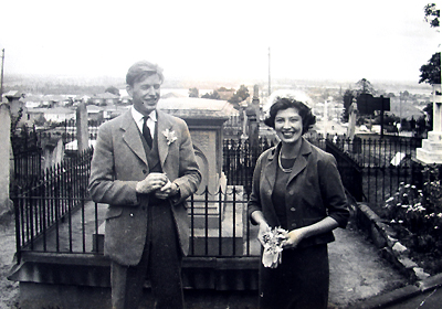 """This photo was taken outside of the church on the day – notice the gravestones in the background."""