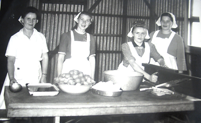 """ This photo is from the Greta migrant camp, taken in the kitchen where I worked for 12 months. I was cutting the bread that day. We had to wear aprons and headscarves."""