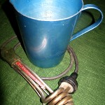 """I had a little Tauchsieder to make hot water for our coffee. You immerse this electric prong into a jug of water and it heats it up. The Tauchsieder came from Germany in my glory box. I bought the blue aluminium jug in Albury in 1959."""