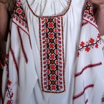 """I embroidered the orange and white blouse; it is traditional Ukrainian embroidery but done in colours that I like. The other blouse [is unique]; I never saw it anywhere except in my village."""