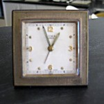 """I brought a clock at Cooma in the Snowy River back in 1953. The alarm would wake me each morning for work. It is a Cyma clock from Switzerland and I paid £15. It was a lot of money then. It is still working very well."""