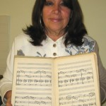 Angelita Gomez with her uncle's music book