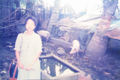 Phiny revisits her family home, Phnom Penh, Cambodia, 1989