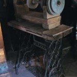 The Graham brothers lived in the Heritage Cottage for 40 years. The New Zealander men adapted this Singer treadle to run the wheels for rubbing down opal. Photograph Lightning Ridge Historical Society