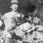 Chinese market gardener on 'Toorale' with a cauliflower - Bourke, NSW, c.1930. Courtesy State Library of NSW.
