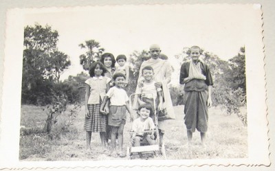 Lina is in the pram with her cousin, three siblings, mother, uncle and paternal grandmother in Battambang province, Cambodia, c. 1961