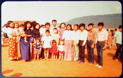 Their last day in the refugee camp: Theau with his family and friends, Khao-I-Dang, Thailand, October 1982