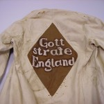 Holsworthy internees coat with 'God punish England' sewn on to the back. Australian War Memorial collection