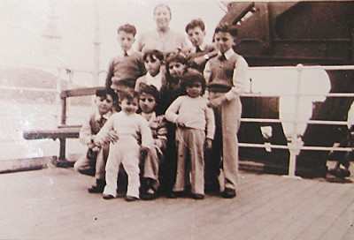 Joe's mother Josephine and Borg and Vassallo children en route to Australia on the Ocean Victory, February 1950. Joe Borg is standing on the left. His future wife, Annie Vasallo, is crouching at the front