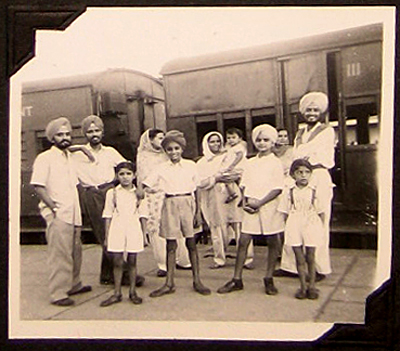 Family farewell Sardool as he begins his journey to Australia, Amritsar station, Punjab, India, June 1954 (Sardool is standing, first on right. His mother is in the middle, holding a child.)